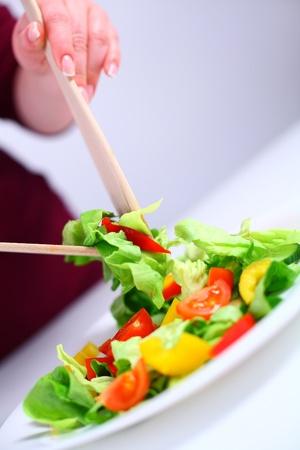 Salad on a white plate, shallow DOF photo
