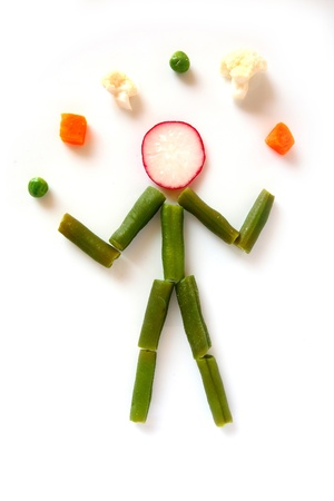 Vegetable person juggling vegetables Standard-Bild