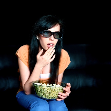 Young woman wearing 3D glasses Stock Photo