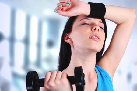 weary: Woman working out at the gym Stock Photo