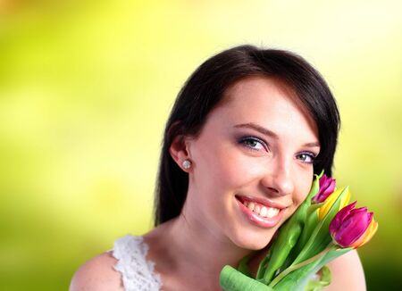 Young woman holding colorful tulips photo