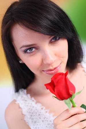 Sexy woman smelling a rose photo
