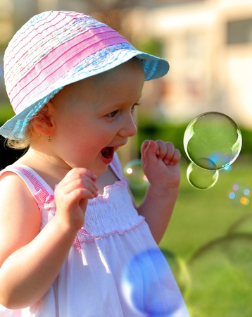 2 year old: Little girl having fun with some soap bubbles Stock Photo
