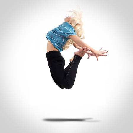 Young woman dancing and jumping photo