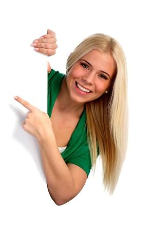 apontador: Jovem, mulher, apontando para algo. Isolado no branco. Banco de Imagens
