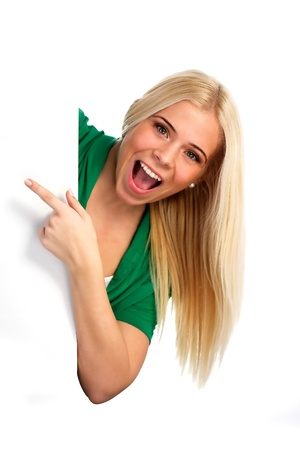 Cheerful woman pointing at something. White background Standard-Bild