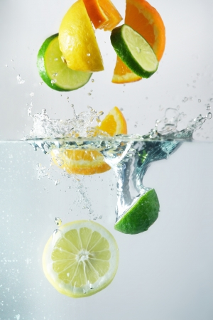 Lemon, lime and orange splash in clear wather