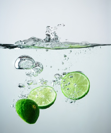 lime slice: Fresh lime splash Stock Photo