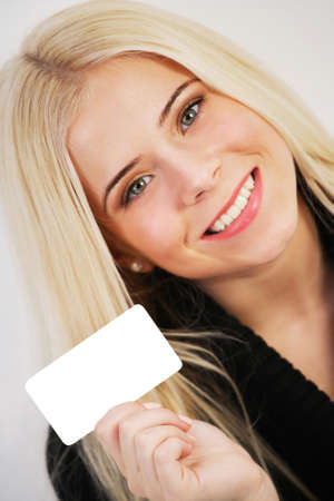 Woman holding a blank gift card Stock Photo - 18941063