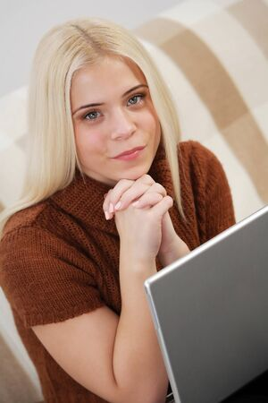 Young woman with laptop computer photo