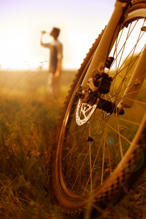 Cyclist relaxing; vertical Stock Photo
