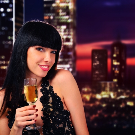 Girl holding a glass of champagne Standard-Bild