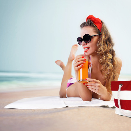red straw: Pin-up girl on the beach