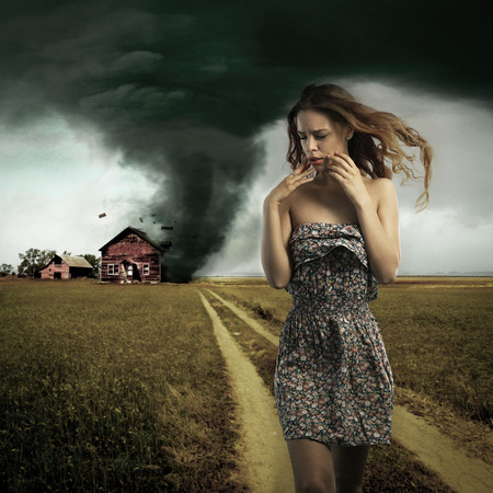 Tornado destroying a woman Stock Photo