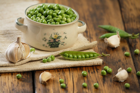 Green peas on the kitchen table photo