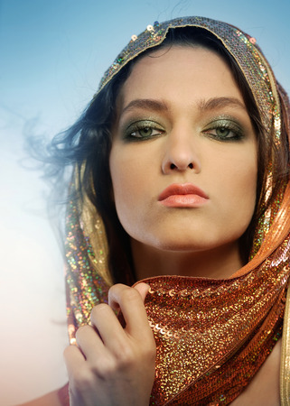 Woman wearing glamorous make up and sequin hoodie Stock Photo