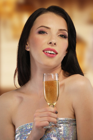 Woman with a glass of champagne photo