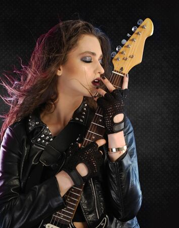 fingerless gloves: Rock star posing with her guitar
