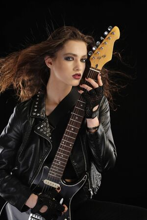 fingerless gloves: Rock star and her electric guitar Stock Photo
