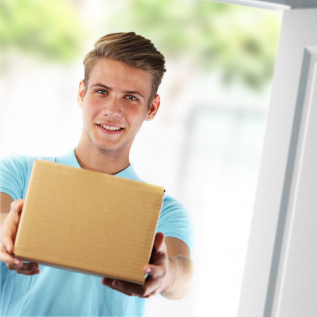 Young courier delivering a package