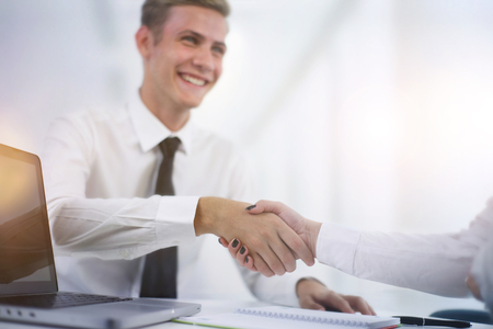 applicant: Hand shake at the end of a business meeting