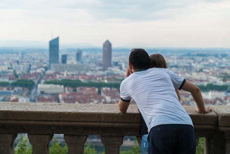 A young couple contemplates the view on the heights of Lyon