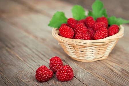 raspberries in a wooden bowl photo