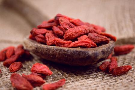 lycium: Goji berries on wooden table Stock Photo