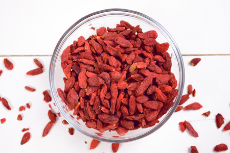 lycium: Goji berries on the wooden table Stock Photo