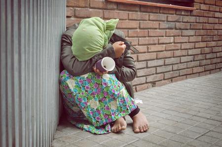 homeless girl is begging for money Stock Photo