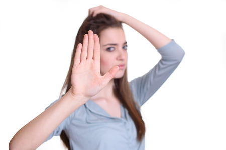 bad attitude: Portrait young annoyed angry woman with bad attitude giving talk to hand gesture with palm