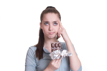 craving: Portrait sad young woman tired of diet restrictions craving sweets chocolate Stock Photo