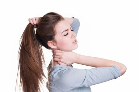 crick: Young woman suffer from neck pain Stock Photo
