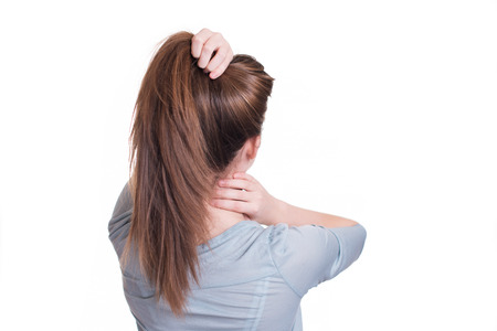 Young woman suffer from neck pain Stock Photo