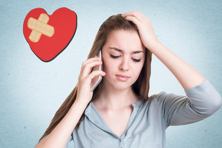 hearted: Broken hearted girl talking on the cell phone Stock Photo
