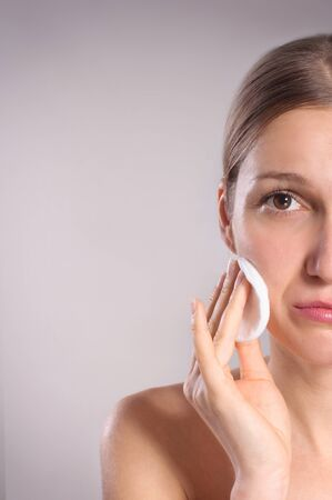 cotton swab: Beautiful woman cleaning her face with cotton swab Stock Photo
