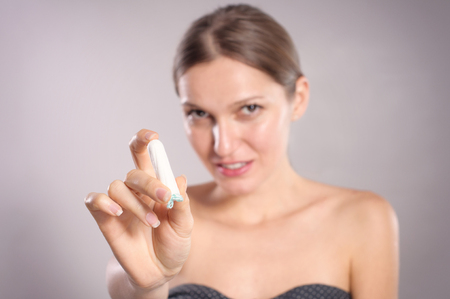gynecologic: Happy young woman showing tampon Stock Photo