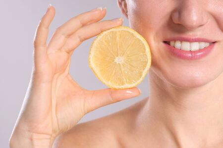 minerals food: Beautiful young woman with lemons. Healthy food concept. Skin care and beauty. Vitamins and minerals.