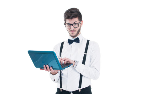 Young business man holding at his laptop with disappointment. Isolated on white background