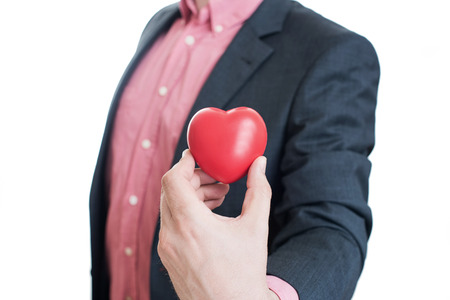 40 year old man: Man holding red heart in his hands