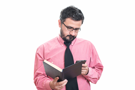 orthography: Young man check grammar mistake of a book