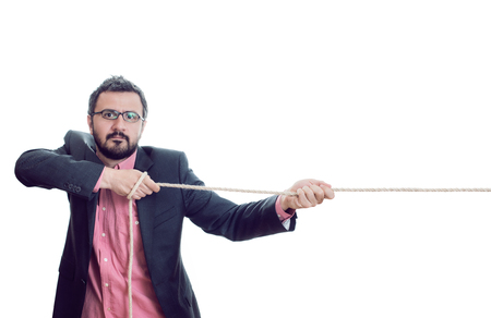 pulling: Man pulling a rope Stock Photo