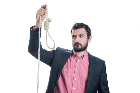 wrongful: Portrait of a businessman with a gallows in his hand Stock Photo