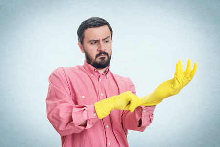 latex glove: Cleaning man putting latex glove and prepare to clean house isolated on white background