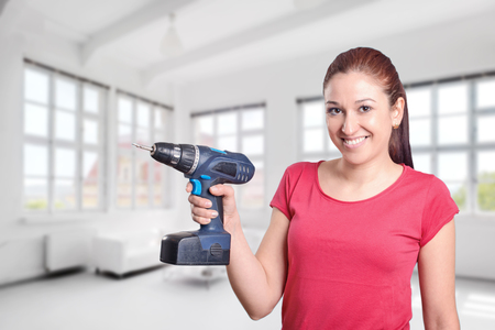 electric drill: Young woman with a electric drill