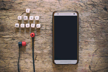 unwound: I love music word on wooden cubes, with cell phone and earphones