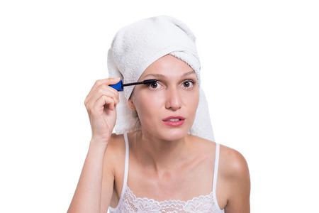 sexy latina: Woman applying black mascara on eyelashes with makeup brush Stock Photo