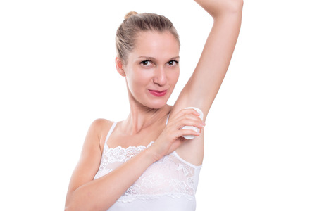 underarms: Beautiful woman putting antiperspirant stick deodorant in underarms