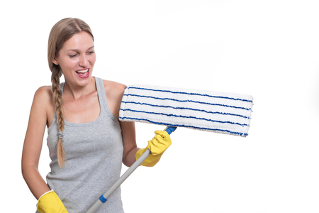 rubber gloves: Cleaning concept. Smiling, happy woman with floor mop and yellow rubber gloves