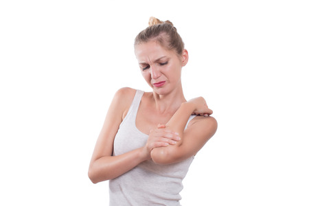 human's elbow: Elbow pain. Young woman holding her elbow, isolated on white background